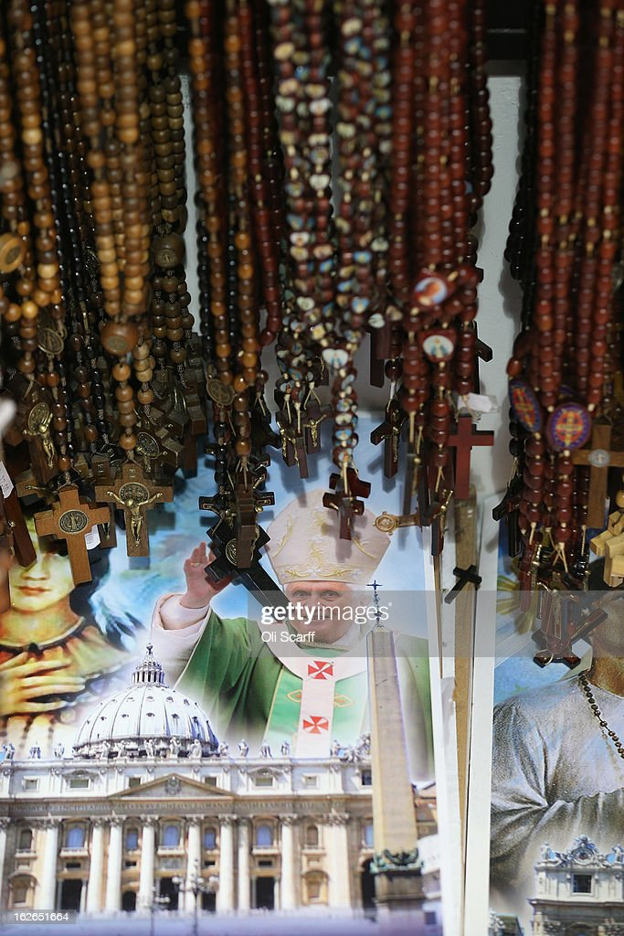Rosary beads are displayed for sale next to an image of Pope Benedict XVI on February 25, 2013 in Rome, Italy. The Pontiff will hold his last weekly public audience on February 27, 2013 before he retires the following day. Pope Benedict XVI has been the leader of the Catholic Church for eight years and is the first Pope to retire since 1415. He cites ailing health as his reason for retirement and will spend the rest of his life in solitude away from public engagements.