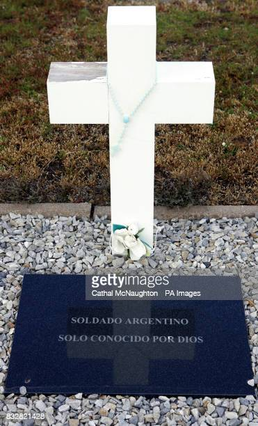 Rosary beads are draped around memorials to all the Argentine soldiers killed during the Falklands war The plaque reads 'A lone Argentine soldier...