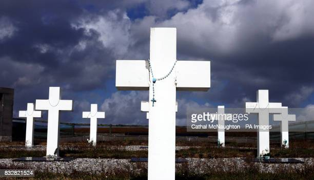 Rosary beads are draped around memorials to all the Argentine soldiers killed during the Falklands war