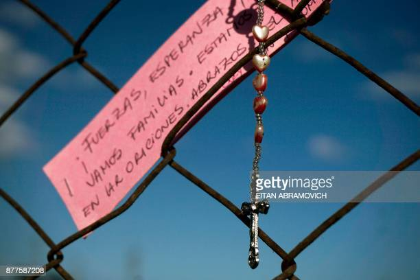 TOPSHOT A rosary hangs outside Argentina's Navy base in Mar del Plata on the Atlantic coast south of Buenos Aires on November 22 2017 The clock...