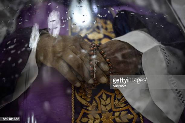 A rosary is seen on the lifeless hands of activist priest Marcelito quotTitoquot Paez who was killed by unidentified assailants during his funeral...