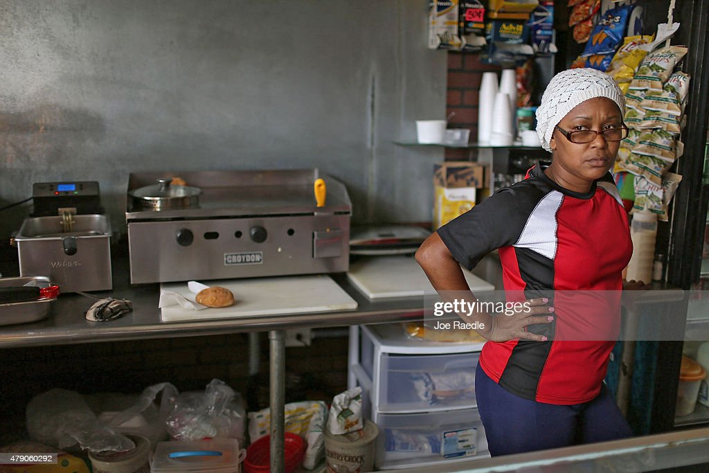 Rosaura Guzman waits for customers at John Cafe a day after Puerto Rican Governor Alejandro Garcia Padilla gave a televised speech regarding the...