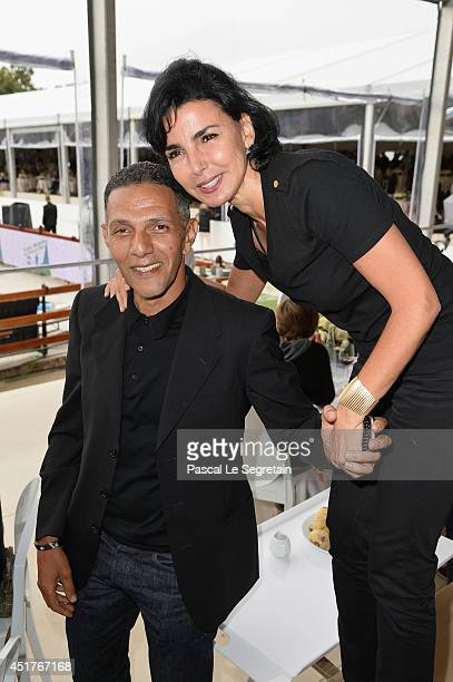 Roschdy Zem and Rachida Dati attend the Paris Eiffel Jumping presented by Gucci at ChampdeMars on July 6 2014 in Paris France