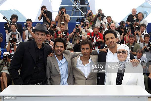 Roschdy Zem Jamel Debbouze Director Rachid Bouchareb Sami Bouajila and Chafia Boudraa attend the 'Outside Of The Law' Photocall at the Palais des...