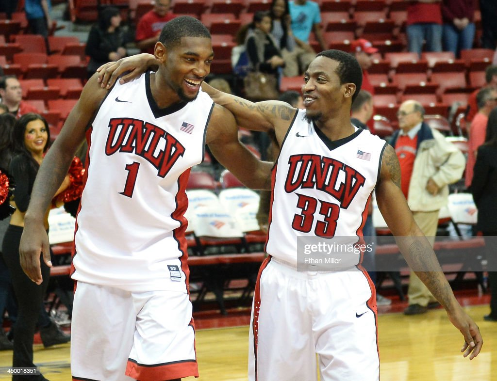 Roscoe Smith #1 and Deville Smith #33 of the UNLV Rebels walk off the court after defeating the Nebraska-Omaha Mavericks 73-70 at the Thomas & Mack Center on November 15, 2013 in Las Vegas, Nevada.