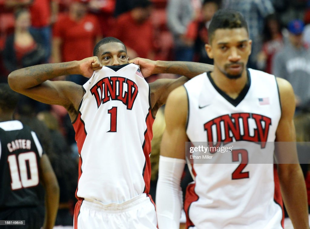 Roscoe Smith #1 and Khem Birch #2 of the UNLV Rebels walk off the court after the Nebraska-Omaha Mavericks missed a 3-pointer as time expired in UNLV's 73-70 win at the Thomas & Mack Center on November 15, 2013 in Las Vegas, Nevada.