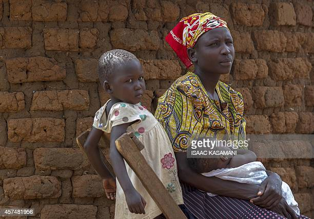 FALLON Rose Akurut a 26 yearold mother of five sits outside her fathers family home in Bukedea district on September 25 after she was chased away by...