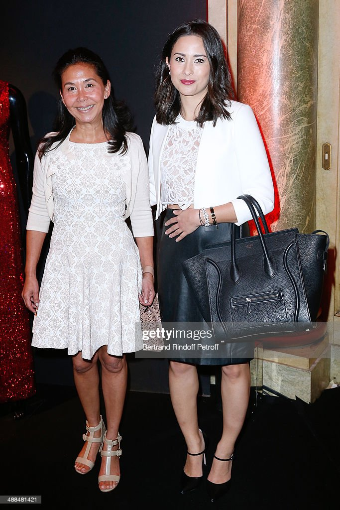 Rose Anne de Pampelone and Anna Ho attend the Cocktail for 50 years of beauty and discovery of new fragrance 'Black Opium' of Yves Saint Laurent on May 6, 2014 in Paris, France.