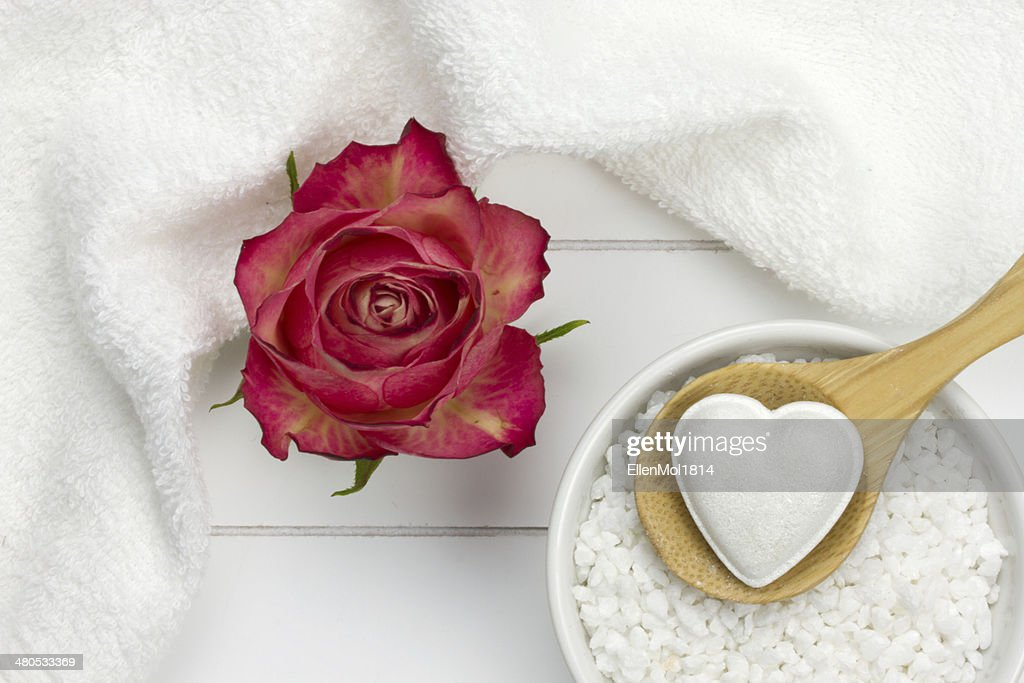 rose, bath fizzer in heart shape on wooden spoon : Stock Photo