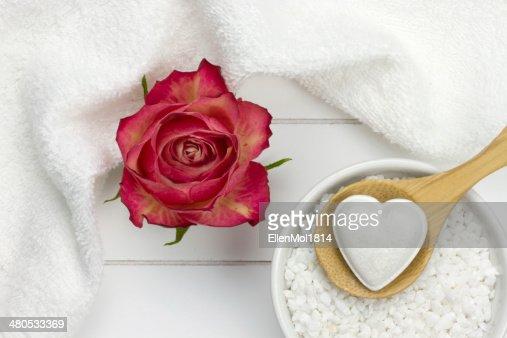 rose, bath fizzer in heart shape on wooden spoon : Stock Photo