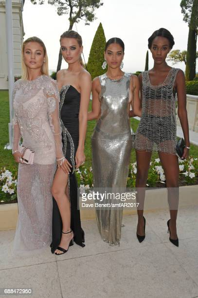 Rose Bertram Bregje Heinen Shanina Shaik and guest arrive at the amfAR Gala Cannes 2017 at Hotel du CapEdenRoc on May 25 2017 in Cap d'Antibes France