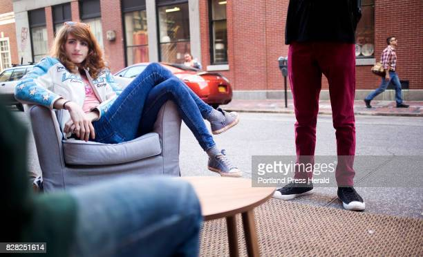 Rose Bloem a sophomore at MECA relaxes in a parking spot 'living room' The parking spot was transformed by Think Tank Coworking for PARK Day 2016...