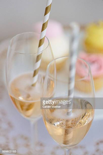 Rose champagne with drinking straws