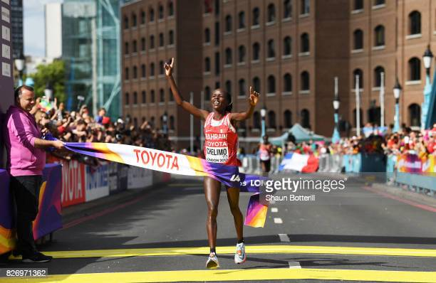 Rose Chelimo of Bahrain celebrates as she crosses the finishline to win the Women's Marathon during day three of the 16th IAAF World Athletics...