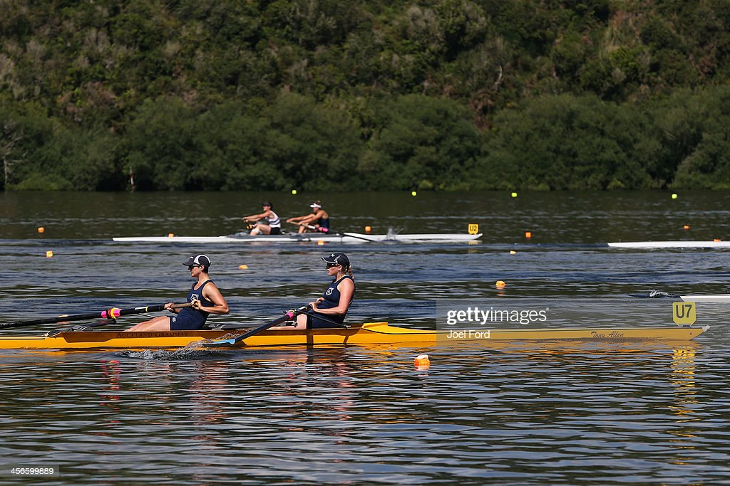 Rose Crooks and Anna Delong of the Auckland Regional Performance Centre compete in the women's premier coxless pairs during the Christmas Regatta 1 at Lake Karapiro on December 15, 2013 in Cambridge, New Zealand.