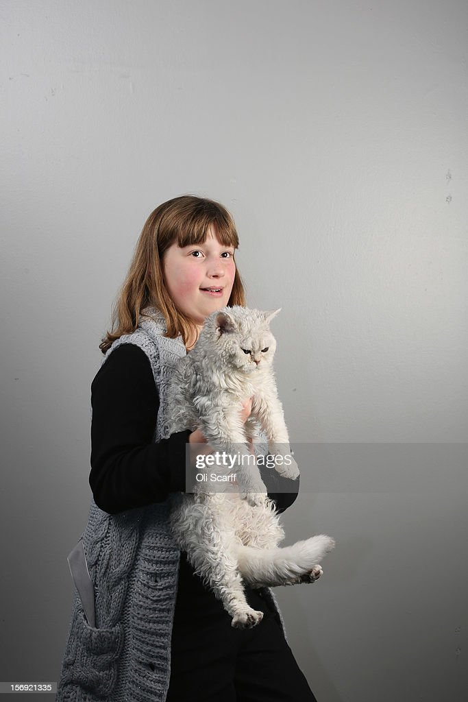 Rose Derbyshire, 12, poses for a photograph with her Selkirk Rex kitten named 'Curly Wirly' after being exhibited at the Governing Council of the Cat Fancy's 'Supreme Championship Cat Show' held in the NEC on November 24, 2012 in Birmingham, England. The one-day Supreme Cat Show is one of the largest cat fancy competitions in Europe with over one thousand cats being exhibited. Exhibitors aim to have their cat named as the show's 'Supreme Exhibit' from the winners of the individual categories of: Persian, Semi-Longhair, British, Foreign, Burmese, Oriental, Siamese.