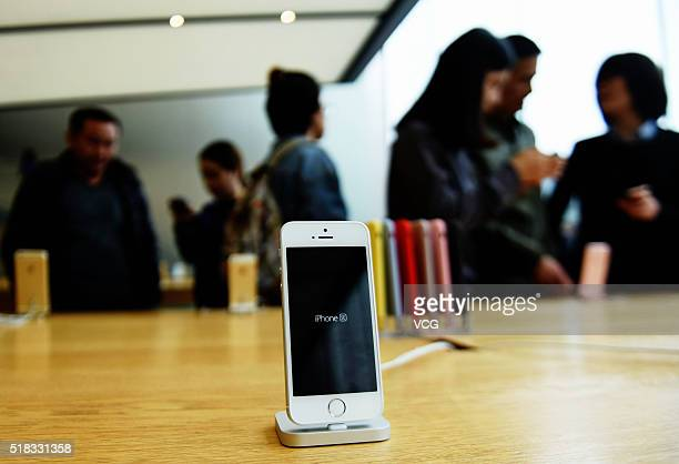 A rose gold iPhone SE is seen at an Apple Store on March 31 2016 in Hangzhou Zhejiang Province of China Apple launched a new 4inch iPhone SE globally...