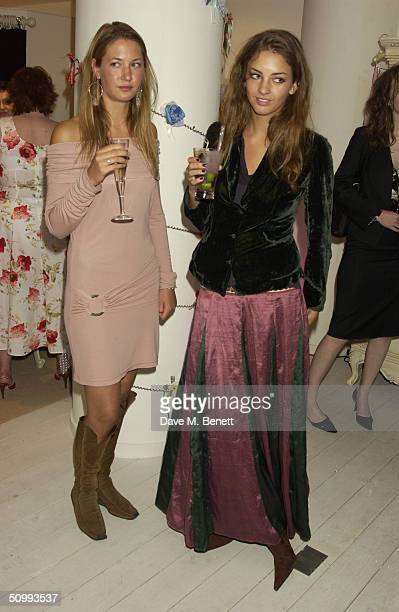 Rose Hanbury and Emma Lopes attends the launch of new boutique 'Austique' at its Kings Road location on June 23 2004 in London The women's boutique...