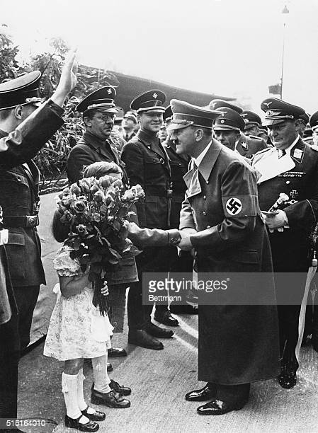 Rose handed out not tossed to Hitler Berlin Germany Adolf Hitler whose face was painfully scratched when a bouquet of roses was tossed into his car...