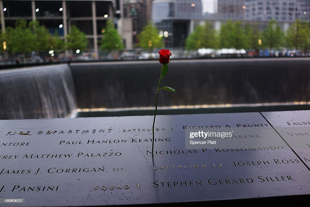 A rose is placed on a name engraved along the South reflecting pool at the Ground Zero memorial site during the dedication ceremony of the National September 11 Memorial Museum in New York May 15, 2014 in New York City. The museum spans seven stories, mostly underground, and contains artifacts from the attack on the World Trade Center Towers on September 11, 2001 that include the 80 ft high tridents, the so-called 'Ground Zero Cross,' the destroyed remains of Company 21's New York Fire Department Engine as well as smaller items such as letter that fell from a hijacked plane and posters of missing loved ones projected onto the wall of the museum. The museum will open to the public on May 21.