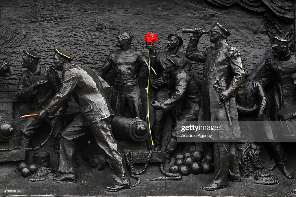 A rose is placed on a statue as tension remains high and the locals follow the process as the a Dianthus is left on the monument at Nakhimov Square, Ukraine on March 4, 2014.