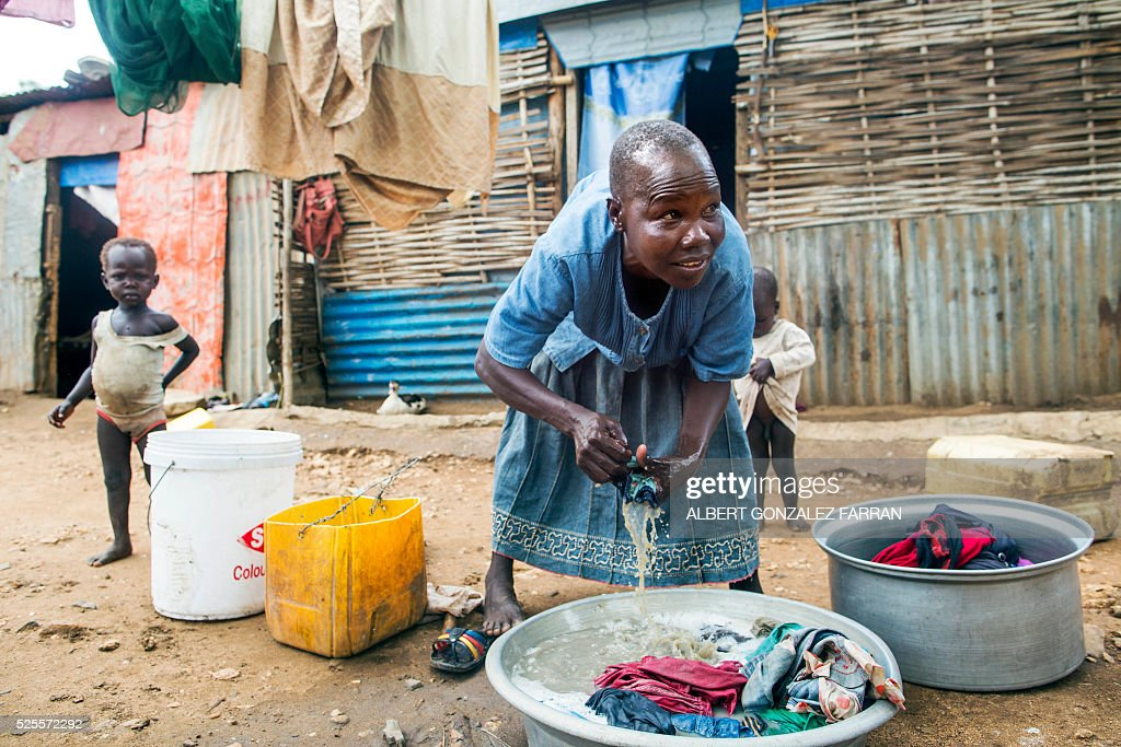 Rose Koluwa, an HIV positive mother of six boys and one girl, does the laundry in front of her shelter in Juba on April 28, 2016. Rose was infected by her husband, who died a bit later. Since then, she lost her job and temporarily quit taking anti-retrovirals because she thought they were not helping her. . South Sudan experiences a generalised HIV epidemic, with concentration of high prevalence in urban areas, basically in the Equatorial region. According to UN AIDS, nearly 3% of the adult population is HIV positive, with 13,000 deaths every year and 18,000 new infections annually. However, these figures should be likely higher if there was a more accurate evaluation among the rural population. / AFP / Albert Gonzalez Farran
