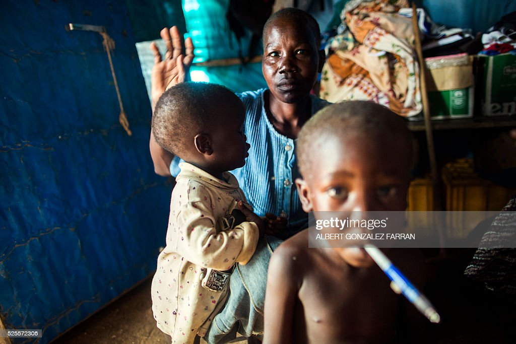 Rose Koluwa, an HIV positive mother of six boys and one girl, poses with her children in her shelter in Juba on April 28, 2016. Rose was infected by her husband, who died a bit later. Since then, she lost her job and temporarily quit taking anti-retrovirals because she thought they were not helping her. . South Sudan experiences a generalised HIV epidemic, with concentration of high prevalence in urban areas, basically in the Equatorial region. According to UN AIDS, nearly 3% of the adult population is HIV positive, with 13,000 deaths every year and 18,000 new infections annually. However, these figures should be likely higher if there was a more accurate evaluation among the rural population. / AFP / Albert Gonzalez Farran