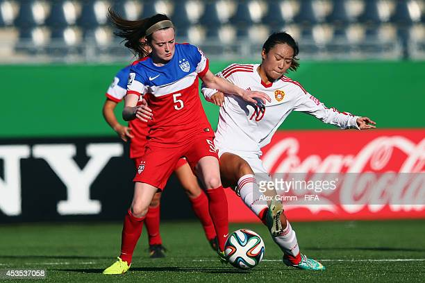 Rose Lavelle of the United States is challenged by Tang Jiali of China PR during the FIFA U20 Women's World Cup Canada 2014 group B match between the...
