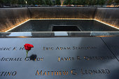 A rose left at the name of Michael Grady during memorial observances held at the site of the World Trade Center on September 11 2014in New York City...