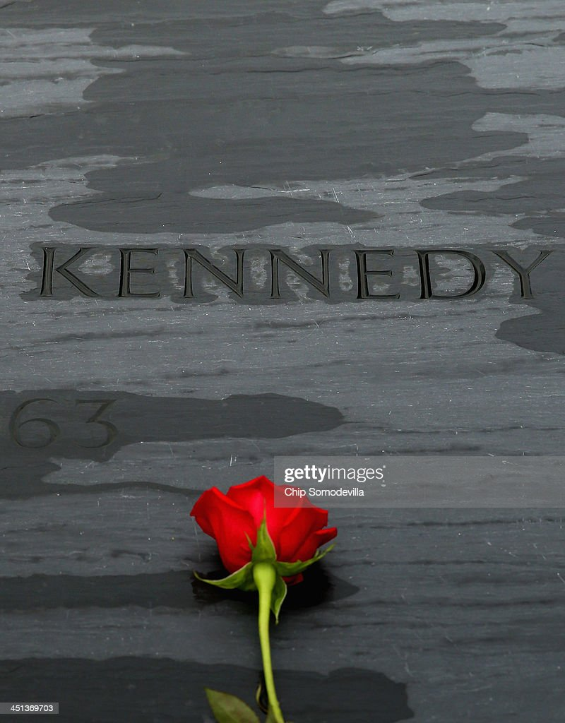 A rose left by family members sits on top of former U.S. President John F. Kennedy's grave marker at Arlington National Cemetery November 22, 2013 in Arlington, Virginia. Remembrance ceremonies will be held arcoss the United States today, the 50th anniversary of the assisination of President Kennedy.