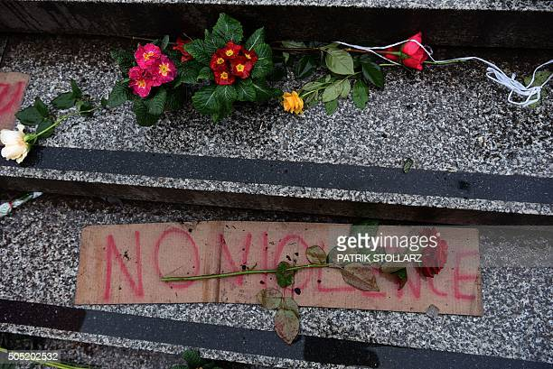 A rose lies on a sign reading 'No Violence' on steps at the Cologne main train station in Cologne western Germany on January 16 2016 where violence...