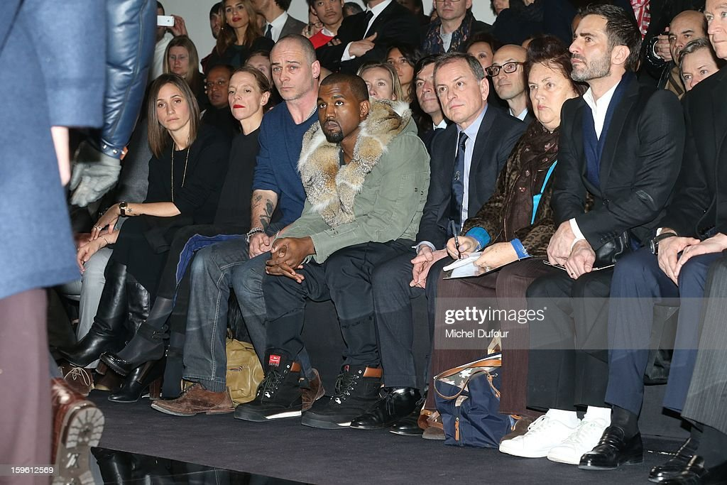 Rose Mary Ferguson, Tiphaine, Dino Chapman, Kanye West, Michael Burke, Suzy Menkes and Marc Jacobs sit in front row at the Louis Vuitton Men Autumn / Winter 2013 show as part of Paris Fashion Week on January 17, 2013 in Paris, France.