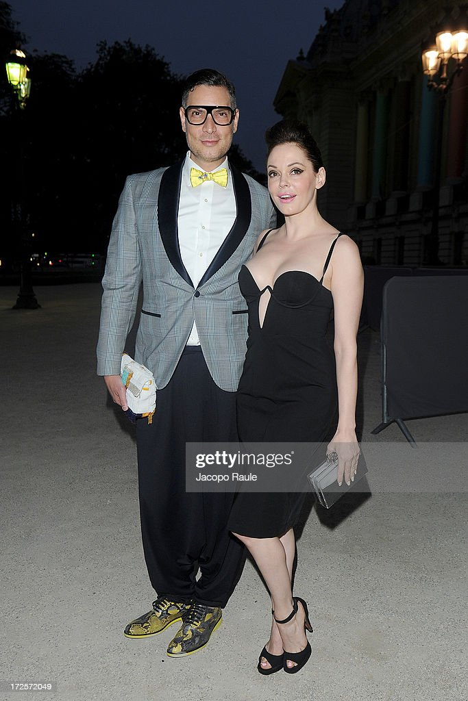 <a gi-track='captionPersonalityLinkClicked' href=/galleries/search?phrase=Rose+McGowan&family=editorial&specificpeople=206451 ng-click='$event.stopPropagation()'>Rose McGowan</a> (R) arrives at 'The Glory Of Water' : Karl Lagerfeld's Exhibition Dinner at Fendi on July 3, 2013 in Paris, France.