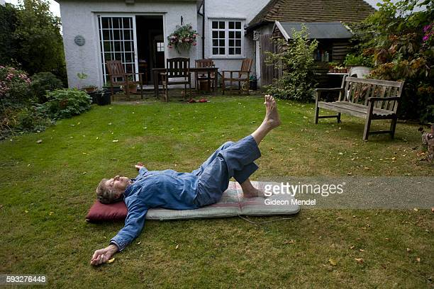 Rose Mendel here aged 84 is the mother of photographer Gideon Mendel Here she does her Pilates exercises in the garden of her home in Hampstead...