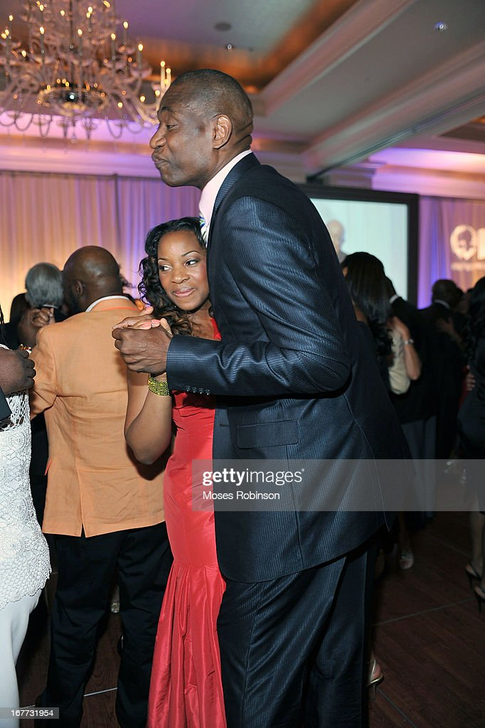 Rose Mutombo with her husband former NBA player Dikembe Mutombo attend the Care For Congo Gala 2013 at the St. Regis Hotel on April 13, 2013 in Atlanta, Georgia.