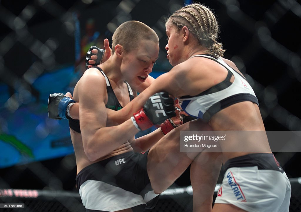 Rose Namajunas knees Paige VanZant in their women's strawweight bout during the UFC Fight Night event at The Chelsea at the Cosmopolitan of Las Vegas on December 10, 2015 in Las Vegas, Nevada.