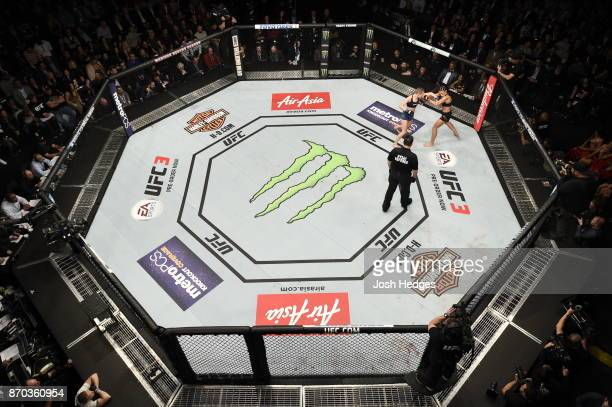 Rose Namajunas lands a punch against Joanna Jedrzejczyk of Poland in their UFC women's strawweight championship bout during the UFC 217 event at...
