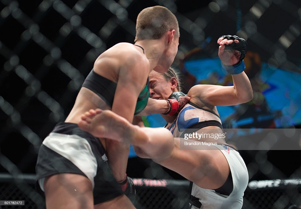 Rose Namajunas punches Paige VanZant in their women's strawweight bout during the UFC Fight Night event at The Chelsea at the Cosmopolitan of Las Vegas on December 10, 2015 in Las Vegas, Nevada.