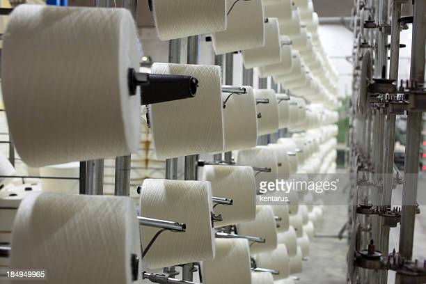 Rose of spools of string in a textile plant