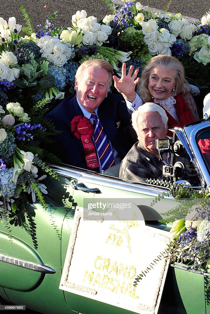 Rose Parade Grand Marshall <a gi-track='captionPersonalityLinkClicked' href=/galleries/search?phrase=Vin+Scully&family=editorial&specificpeople=878517 ng-click='$event.stopPropagation()'>Vin Scully</a> attends the 2014 Rose Parade on January 1, 2014 in Pasadena, California.