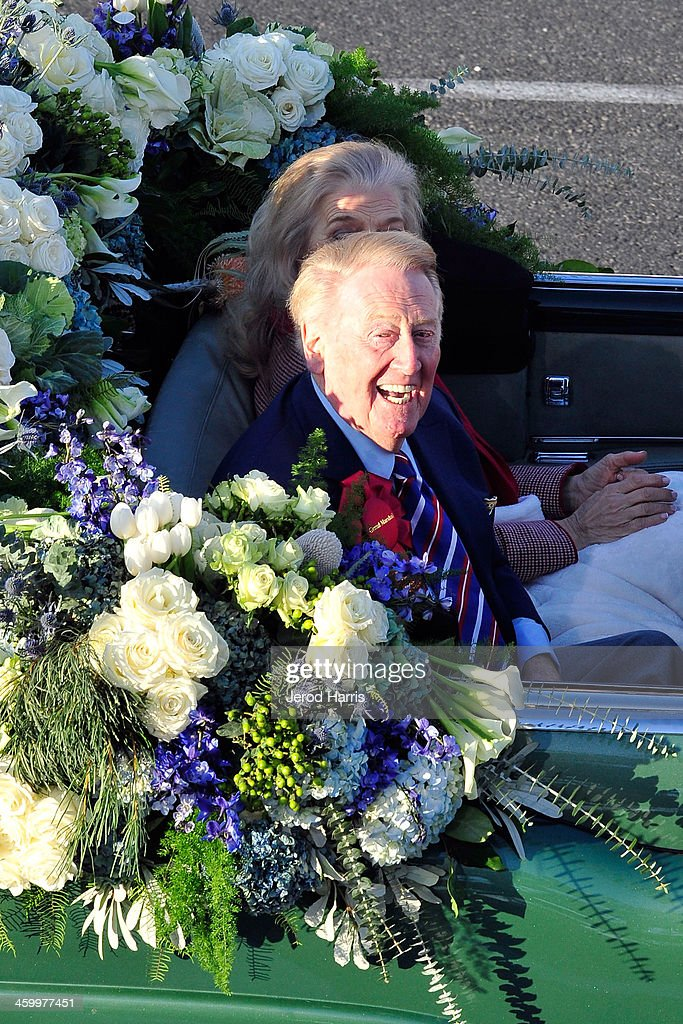 Rose Parade Grand Marshall <a gi-track='captionPersonalityLinkClicked' href=/galleries/search?phrase=Vin+Scully&family=editorial&specificpeople=878517 ng-click='$event.stopPropagation()'>Vin Scully</a> smiles during the 2014 Rose Parade on January 1, 2014 in Pasadena, California.