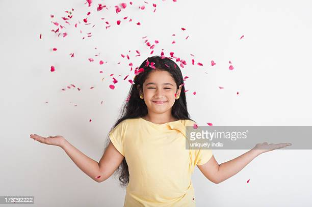 Rose petals falling on a girl
