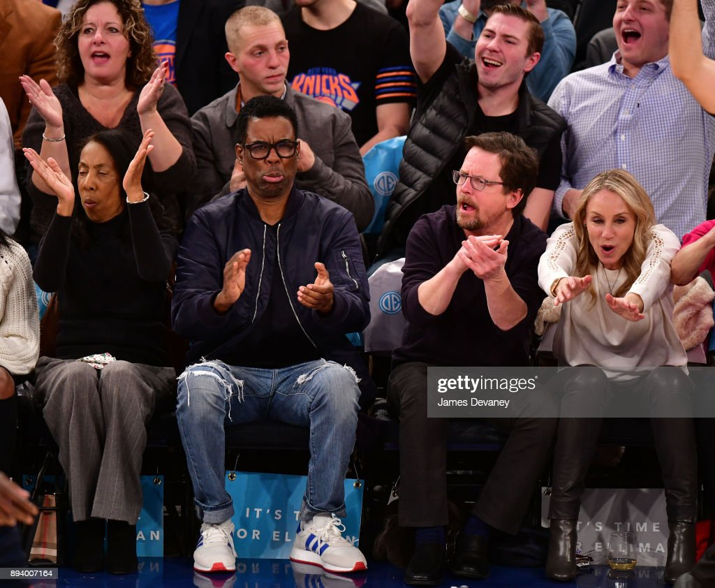 Rose Rock, Chris Rock, Michael J. Fox and Tracy Pollan attend the Oklahoma City Thunder Vs New York Knicks game at Madison Square Garden on December 16, 2017 in New York City.