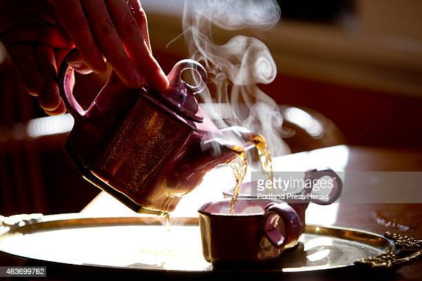 Rose tea at Dobra Tea on Exchange Street Thursday January 29 2015 is poured from a double spouted tea pot Both items are featured in Valentine's...