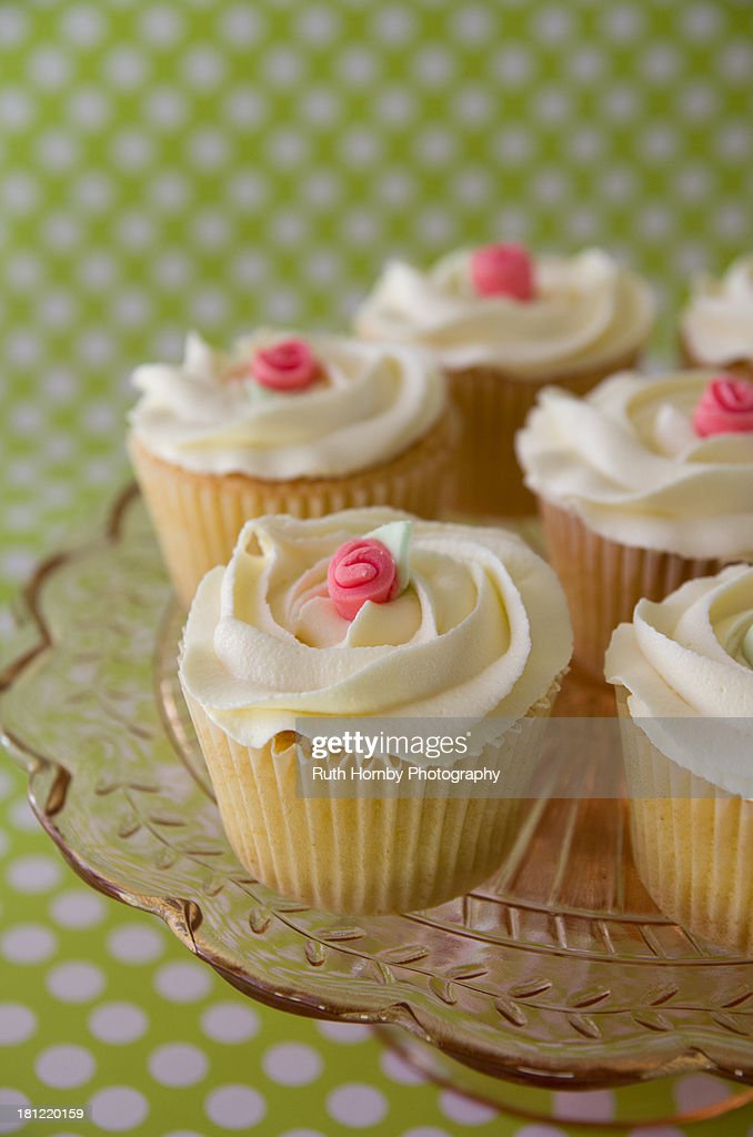 Rose topped cupcakes : Stock Photo
