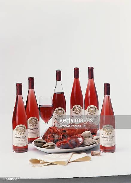 Rose wine bottles with lobster and oyster in plate