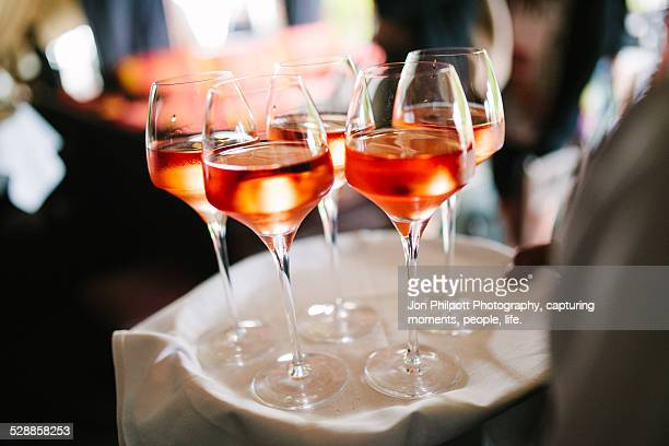 Rose wine drinks on tray