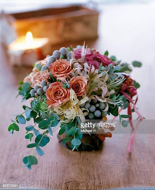Rose,eucalyptus,silver bologna,carnation in vase