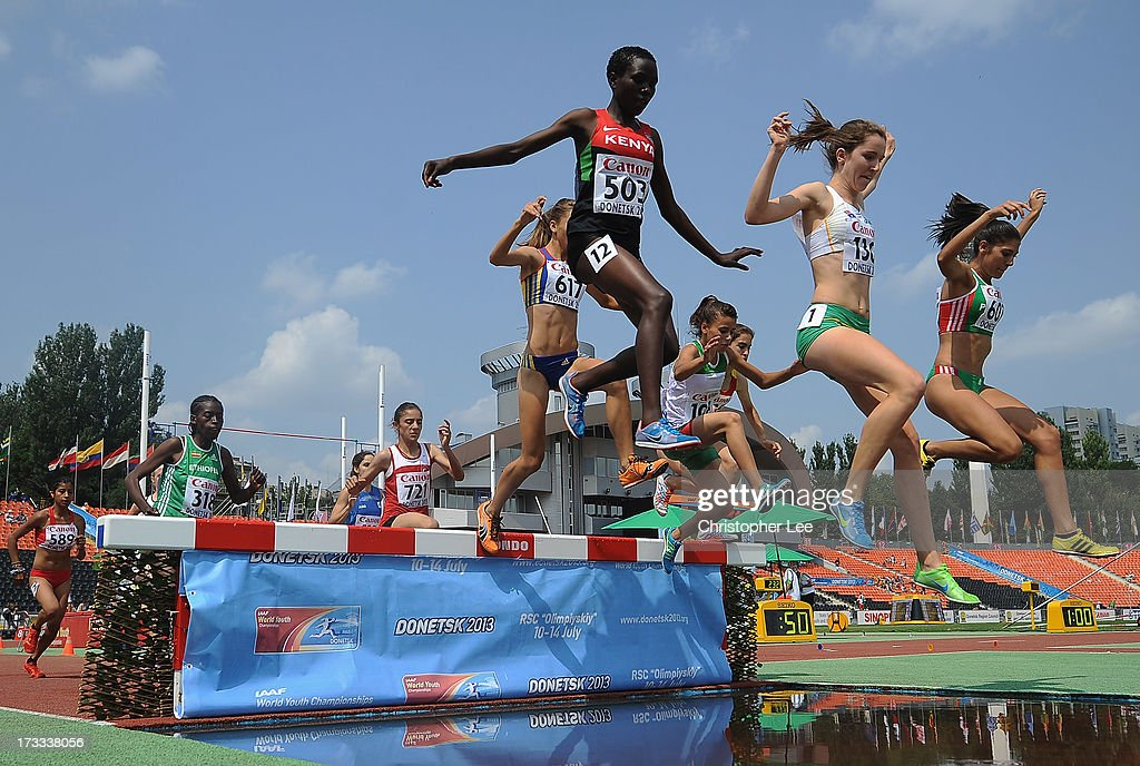 Rosefline Chepngetich of Kenya, Amy McCormick of Australia and Sabrina Yahi of Algeria lead the pack in the Girls 2000m Steeplechase Round 1 race during Day 3 of the IAAF World Youth Championships at the RSC Olimpiyskiy Stadium on July 12, 2013 in Donetsk, Ukraine.