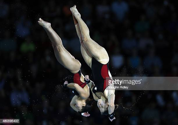 Roseline Filion and Meaghan Benfeito of Canada compete and win Gold in the Women's 10m Synchro Final during the Toronto 2015 Pan Am Games at the CIBC...